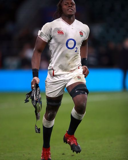 England's Maro Itoje with the triple crown trophy after beating Wales in the Guinness Six Nations ma
