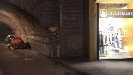 Contrasting situations in Morning Lane: Rough sleeper tents in Churchwell Path beside glitzy Hackney