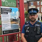 Southwold PCSO Ben Hedley-Lewis outside the phone box where letters can be posted. Picture: Suffolk