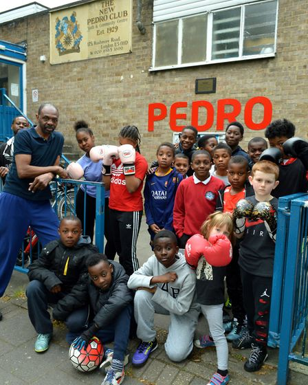 James Cook MBE, left, with members of the Pedro Youth Club's boxing club. Picture: Polly Hancock