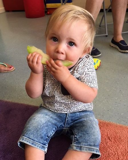 Toddler George Hill tucks into a slice of melon at ECCH's Tiny Tummies Café. Pictures: East Coast Co