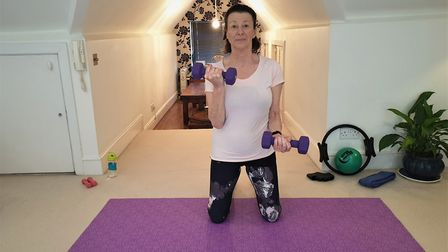 Ginny Greenwood at home doing one of her free pandemic pilates sessions