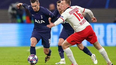 Tottenham Hotspur's Giovani Lo Celso (left) and RB Leipzig's Lukas Klostermann battle for the ball (