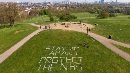 'Stay 2m apart' - message warns park users to social distance at Primrose Hill. Picture; Camden Coun