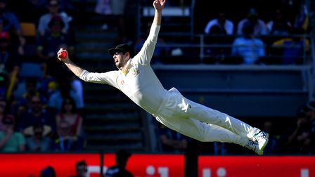 Kurtis Patterson of Australia is seen diving to take a catch to dismiss Dilruwan Perera of Sri Lanka