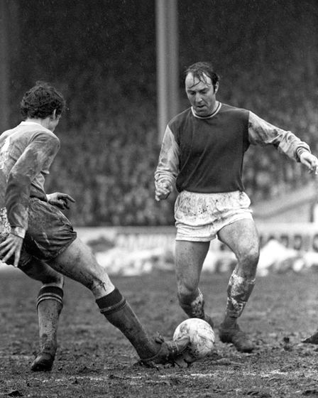 Jimmy Greaves, making his debut for West Ham United in their 5-1 win over Manchester City, is tackle