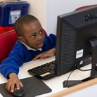 Children using computers at school. Picture: Supplied
