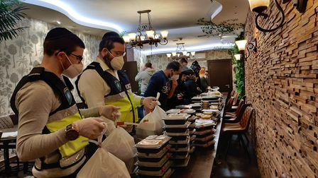 The Orthodox Jewish voluntary neighbourhood watch group Shomrim has been distributing food to people