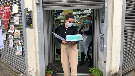 Neighbours wished dedicated pharmacy manager Gizem Ergisi a happy birthday by making her a NHS blue