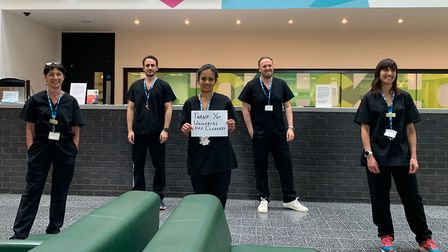 Doctors at the James Wigg GP Practice in Bartholomew Road wearing the scrubs. Picture: Universal Dry