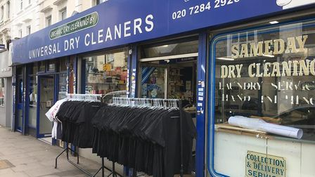 A line of freshly produced scrubs outside the dry cleaners in Brecknock Road. Picture: Universal Dry
