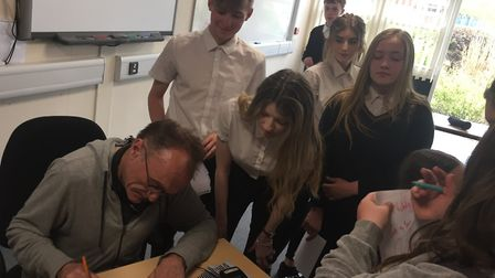 Ormiston Denes Academy students line up for autographs from Danny Boyle during his recent visit ahea