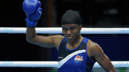 England's Nicola Adams prepares to fight against Nigeria's Oluwatoyin at the 2014 Commonwealth Games