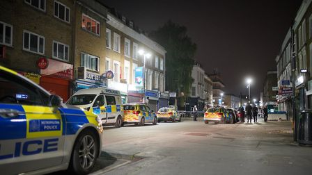 Police investigate a shooting in Queens Crescent. Picture: Barnaby Nerberka