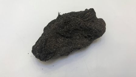 A piece of the contaminant found at Gunton Warren. Picture: Amy Smith.