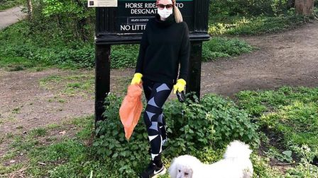 Emma Lumsden with her dog out litter-picking on the Heath. Picture: Emma Lumsden