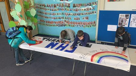 Pupils from Fortismere School penning a NHS tribute. Picture: Fortismere School