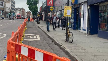 The pavement has been widened in Camden High Street to help maintain two-metre distancing. Picture: