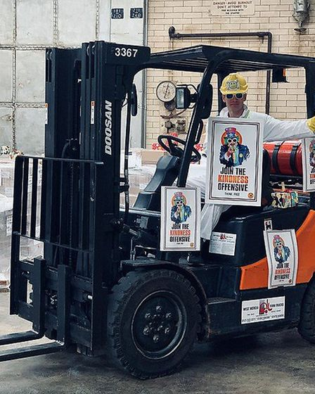 One member of the team, Peter Knupffer, has learnt to drive a forklift donated to the cause. Picture