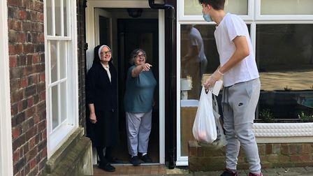 Nicolo Di Borgoricco, 16, dropping off bananas and oranges to nuns at St Dorothy's Convent. Picture: