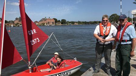 The new president of Lowestoft East Point Rotary Club, Martin Lott, presents a new Hansa 303 boat to