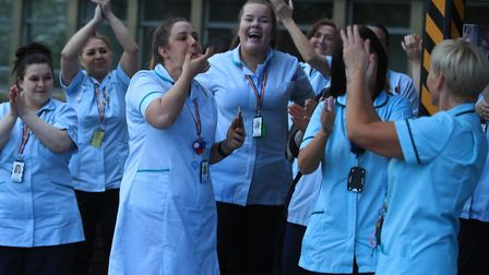 NHS workers during the weekly claps for carers. Picture: PA