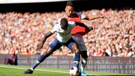 Arsenal's Pierre-Emerick Aubameyang, (right) battles for possession of the ball with Tottenham Hotsp