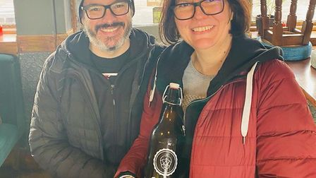 Customers with their two-pint growler. Picture: Rose & Crown