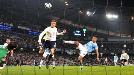 Tottenham Hotspur's Peter Crouch (left) scores the winning goal against Manchester City on May 5, 20