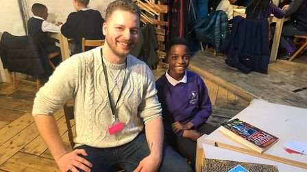 Young pirate Joe with a volunteer at the Literacy Pirates' Hackney ship. Picture: L&Q