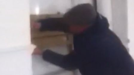 The men barricaded the door but were eventually arrested. Picture: Krasimir Zashev