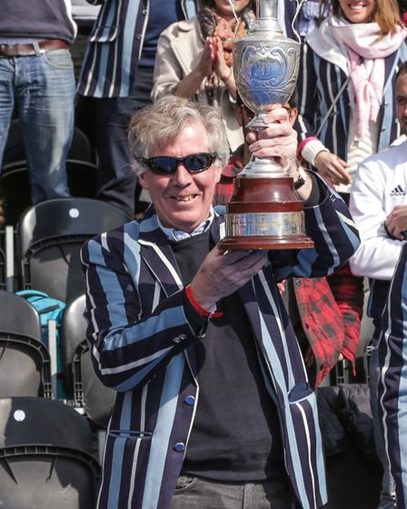 Hampstead & Westminster supporters show off the trophy (pic Mark Clews)