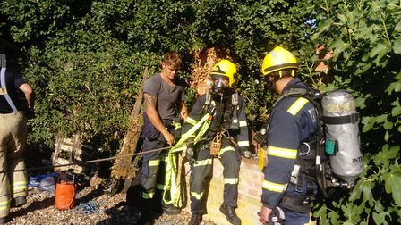 Ollie the cockapoo was rescued by firefighters after falling down a well. Picture: Suffolk Fire and