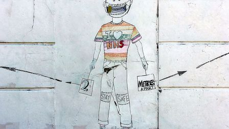 Pharmacy volunteer Michelle May made this mural of a socially distancing NHS boy on the side of Safe