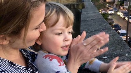 Lucy Wood and her son Lochie clap for carers in Stoke Newington. Picture: Graeme Edie
