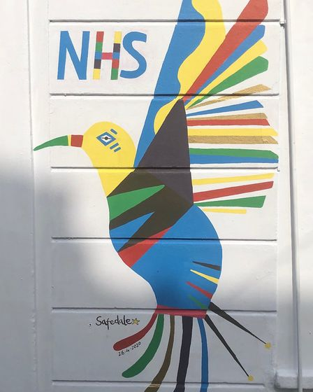 A mural on the side of Safedale pharmacy in Stoke Newington. The hummingbird symbolises hope and was