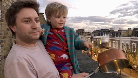 Graham Edie and his 4 year-old son Lochie Clap for Carers on Oldfield Road. Picture: Lucy Wood