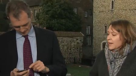 David Davies MP checks his phone during Sky News interview. Photograph: Sky News.