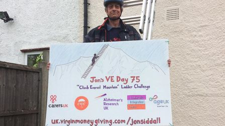Jon Siddall during his challenge to 'climb Everest' in his West Hampstead garden. Picture: Nicki Sid