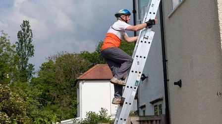Jon Siddall during his challenge to 'climb Everest' in his West Hampstead garden. Picture: Philip Wo