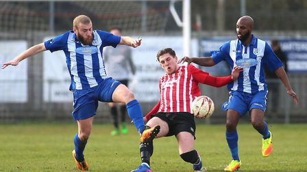 Jed Chouman of Hornchurch tangles with Murat Karagul (left) and Bradley Woods-Garness (right) of War