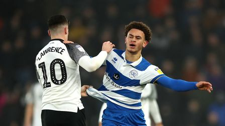 Derby County's Tom Lawrence (left) and Queens Park Rangers' Luke Amos battle for the ball