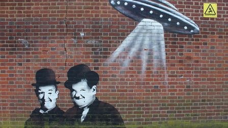 Street art at Turnpike Lane tube, where The Ritz cinema used to stand. Above Laurel and Hardy is a f