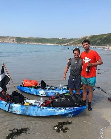 Jack Gatacre and friend Raf after completing their London to Land's End kayaking challenge