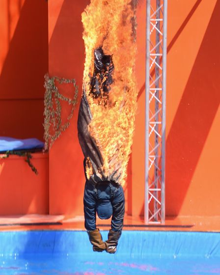 A diver on fire dives from a high board in the new Magical Mayan Temple high dive show at Pleasurewo