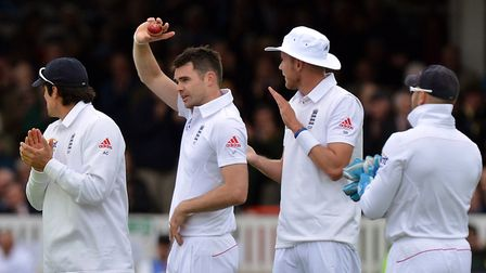 England's James Anderson holds the ball after taking his 300th test wicket at Lord's