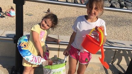 Vienne, 3, and Priya, 7, collected a whole bag of rubbish from Lowestoft's South Beach. Picture: Ave