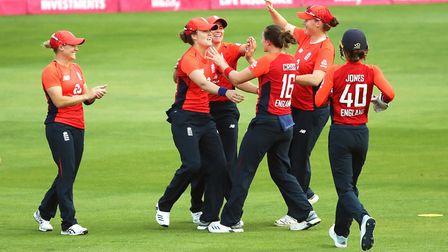 England Women's Nat Sciver (second left) celebrates with team-mates after catching out Australia Wom