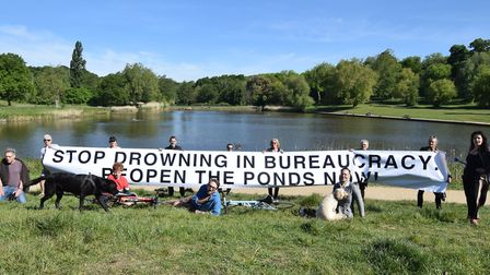 A group of pond swimmers protest the continued closure of the Heath's bathing ponds. Picture: Polly