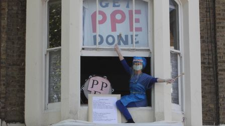 Jane Ralley performing 'Give PPE a Chance' from her home in St John's Grove during the weekly clap f